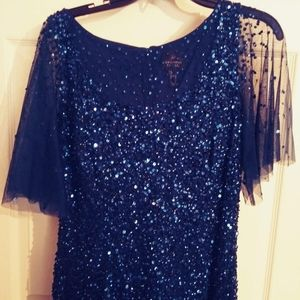 Blue sequined evening gown